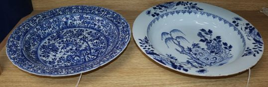 Two Chinese blue and white bowls, 18th/19th century, one with all-over floral and foliate design,