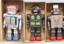 A Horikawa, Japan battery-operated Machine Robot and two other robots, including an Attacking