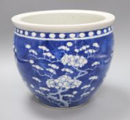 A 19th century Chinese blue and white jardiniere height 23cm
