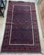A small Belouch rug, woven with three lozenges Approx. 200 x 110cm
