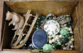 A wooden box containing assorted jewellery etc.