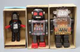 A Horikawa, Japan battery-operated Piston Robot and two other robots, including a Horikawa Attacking