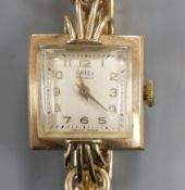 A lady's 9ct gold Trebex manual wind wrist watch, on a 9ct bracelet.