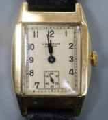 A gentleman's late 1940's 9ct gold manual wind wrist watch, retailed by J.W. Benson, with