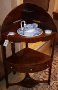 A George III mahogany corner washstand, with blue and white ceramics H.102cm