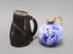 A Royal Doulton 'Blue Lady' jug and a Doulton Black Leather ware jug, with silver mounted rim