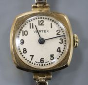 A lady's 9ct gold manual wind wrist watch, on a 9ct gold expanding bracelet.