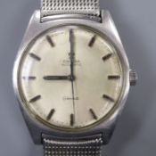 A gentleman's stainless steel Omega automatic wrist watch, on Omega mesh bracelet.