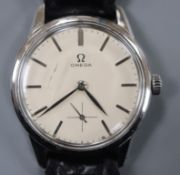 A gentleman's 1960's? stainless steel Omega Seamaster manual wind wrist watch, with baton numerals