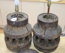 A pair of table lamps made of cartwheels