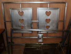 An Arts and Crafts design, steel Voysey style, double bed, with silvered metal head and foot