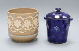 A Doulton silicon ware jardiniere and a blue glazed biscuit barrel and cover, shape 8510, jardiniere