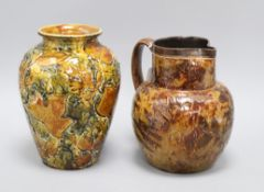A Doulton Lambeth 'Autumn Leaves' globular jug, c.1895 and a similar ovoid vase,