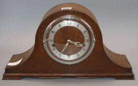 A 1930's oak mantel clock