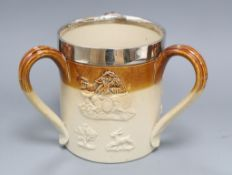 A large Doulton Lambeth Harvest ware silver-mounted three-handled tyg, the mount London 1873, H.
