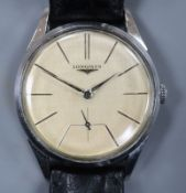 A gentleman's stainless steel Longines manual wind wrist watch, with baton numerals and subsidiary