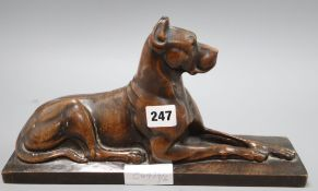 A carved wood figure of a recumbent Great Dane W.32cm