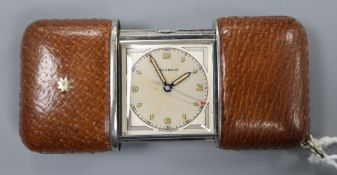 A 1930's steel and leather cased Movado travelling watch.