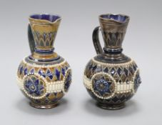 Two similar Doulton Lambeth incised and beaded jugs, assistant's marks GP and AB