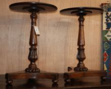 A pair of William IV circular rosewood and mahogany wine tables (altered) H.60cm