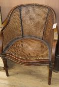 A caned Bergere tub chair