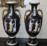 A pair of Greek decorated two handled vases