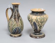 A Doulton Lambeth leaf incised jug, dated 1877, by Elizabeth A Gadson & Fanny Clark and a similar