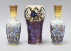 A Royal Doulton stoneware fruit decorated vase, c.1910 and a pair of Doulton Lambeth Slater's Patent
