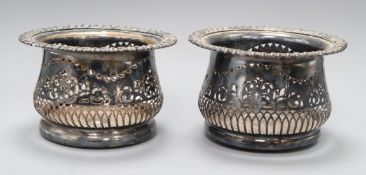 A pair of silver-plated coasters with deep pierced borders H.11cm, 17cm diameter