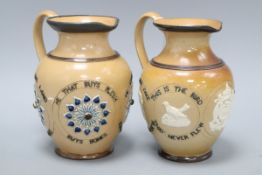 Two Doulton Lambeth motto jugs, c.1884, the first titled 'He that buys land buys stone ...', the