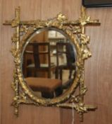 A Victorian gilt and gesso wall mirror H.42cm