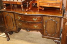 A Chippendale style mahogany bowfront sideboard W.150cm