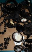 A group of jet and other assorted jewellery, including lockets, necklaces, brooches etc.