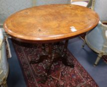 A Victorian inlaid walnut oval topped centre table W.90cm