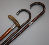 A horn handled and two other silver mounted walking canes