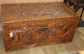 A Chinese carved camphorwood trunk L.105cm