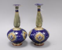 A pair of Royal Doulton stoneware bottle vases, early 20th century, with flame medallions on a
