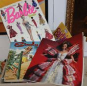 Barbie Case with ten assorted played with Barbies, various magazines and books, bag of assorted mini