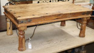 An Indonesian teak and wrought iron coffee table W.102cm