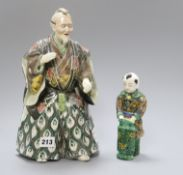 A Japanese Kutani figure of a Samurai general and a figure of a boy tallest 31cm