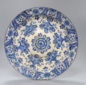 A faience pottery blue and white charger Diameter 34cm