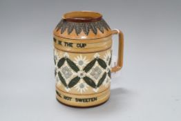 A Doulton Lambeth motto beer jug, c.1895, inscribed 'BITTER MUST BE THE CUP...', H. 18cm