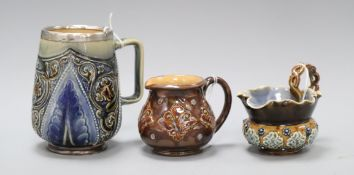 Two Doulton Lambeth milk jugs, c.1900 one with and a similar foliate design mug, dated 1883, with
