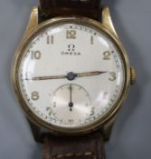 A gentleman's 1950's? 9ct. gold Omega manual wind wrist watch, with Arabic dial and subsidiary