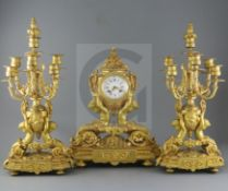 A 19th century French ormolu clock garniture, modelled with putti supporting urns, floral swags