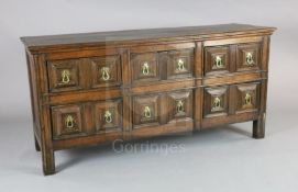 A 17th century style oak dresser base, fitted six geometric moulded drawers with drop handles, on