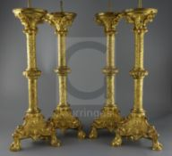 A set of four 19th century French Henri II style ormolu pricket candlesticks, decorated with