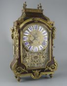 A 19th century French ormolu mounted red tortoiseshell mantel clock, with enamelled tablet