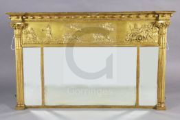 A 19th century Regency style giltwood and gesso overmantel, with classical chariot frieze over