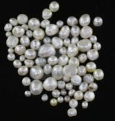 Seventy eight loose undrilled assorted shaped natural pearls, gross weight 52.58cts, with